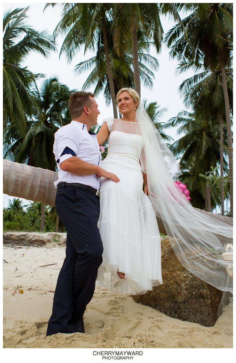 Bride and Groom beach portraits, Koh Samui, Thailand, Destination wedding, sitting on a palm tree