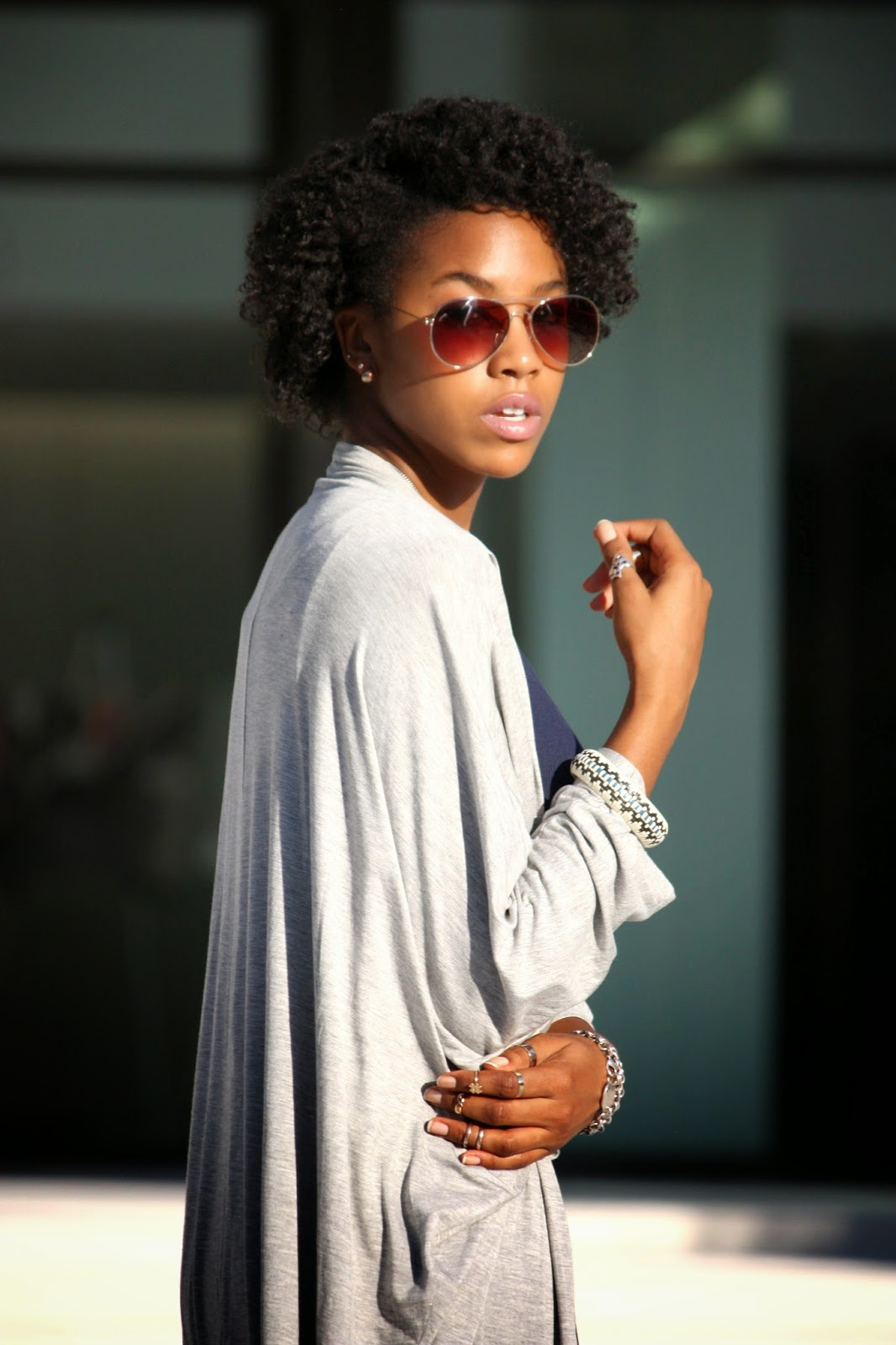 Wearing H&M aviator sunglasses assorted rings vintage bangle and Tiffany & Co bracelets
