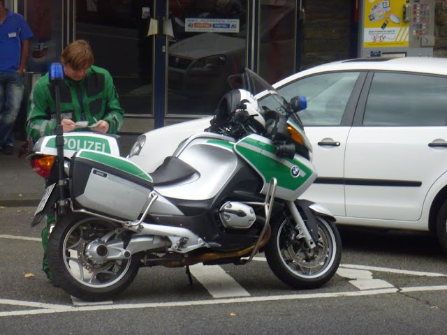 Spotted German policeman with his BMW bike in Cologne, Germany