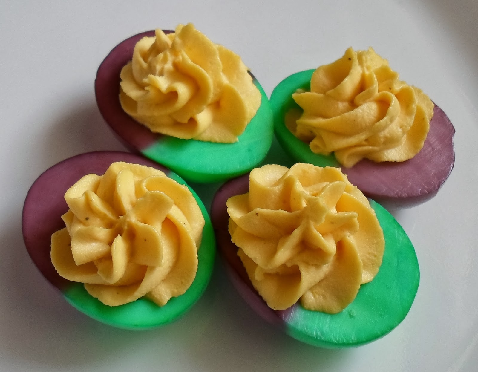 Happier than a pig in mud mardi gras dyed deviled eggs simply use food coloring and dip half of each peeled egg into green and the other half into purple the gold kinda takes care of itself use your favorite forumfinder Choice Image