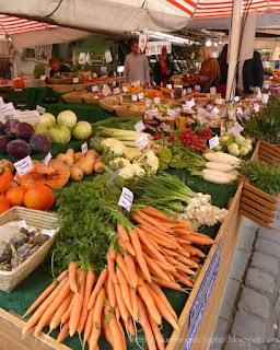 Market stand with carrots, cabbage and other vegetables