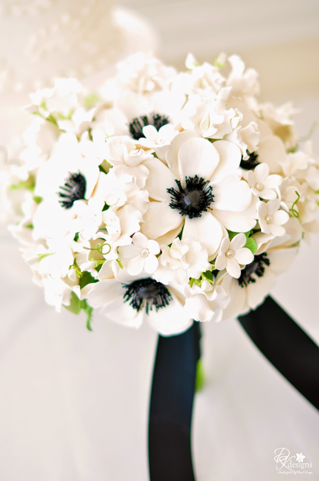 Designs anemone bouquet and boutonniere izmirmasajfo Images