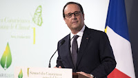 French President Francois Hollande delivers a speech during the opening of the Consciouness Summit in Paris, France, Tuesday, July 21, 2015. (Credit: Etienne Laurent / Pool Photo via AP) Click to Enlarge.