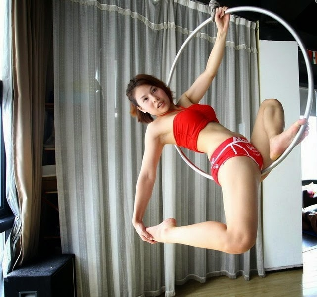 Pole dancers practicing on Olympic ring to soften body
