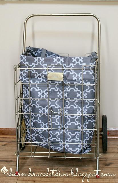 vintage rolling metal cart repurposed as laundry basket