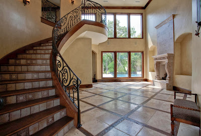 gorgeous stairs and open foyer with natural sunlights