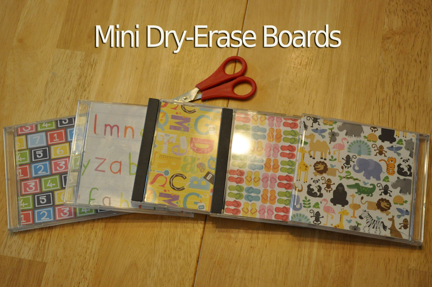 Scrapbook paper case - We Picked Some Fun Scrapbook Paper And Slid It Into An Empty Cd Case You Can Put It On The Patterned Side And Circle Things Or Do Colors Or Objects