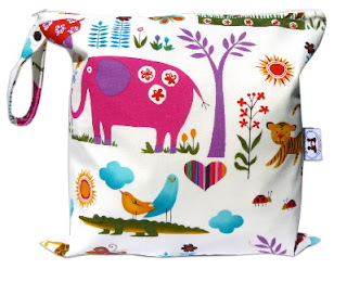 A diaper wetbag with elephants and other animals displayed on it