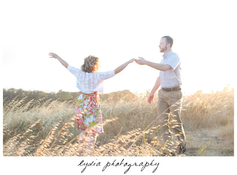 Bride and groom dancing at lifestyle engagement portraits in the Bay Area of California