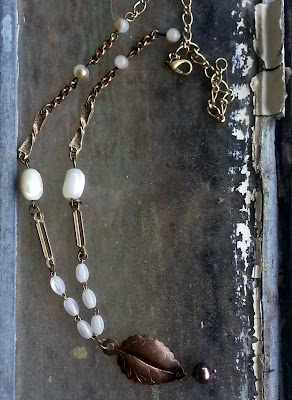 Assemblage necklace with rosary beads, recycled beads and chains.