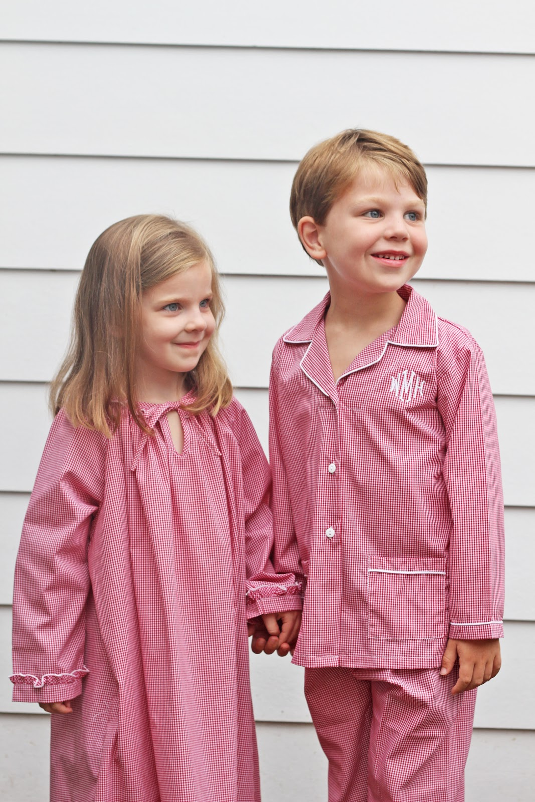 christmas morning comes in style with these adorable red gingham monogrammed childrens pajamas available in sizes 12m to 8 in pajama style or ruffled