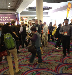 Mike in the sea of CES attendees, navigating with his guide dog Tank