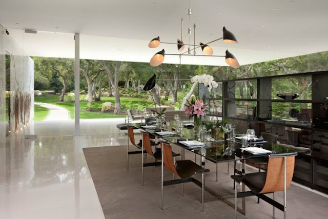 Photo of modern dinning room with glass dinning table