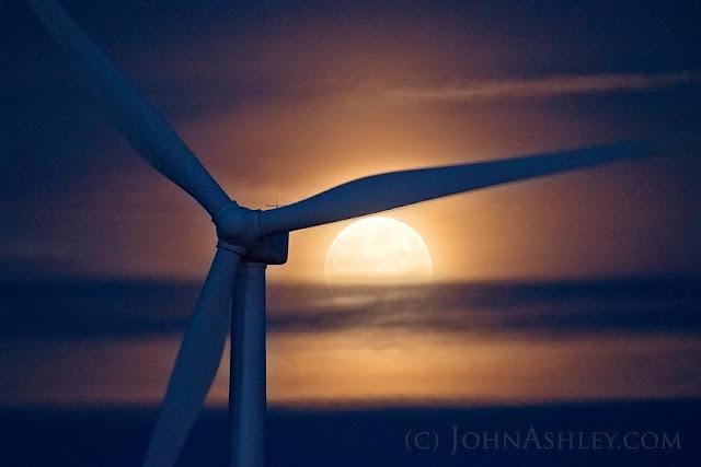Full moon rising behind wind turbine near Shelby, MT (c) John Ashley