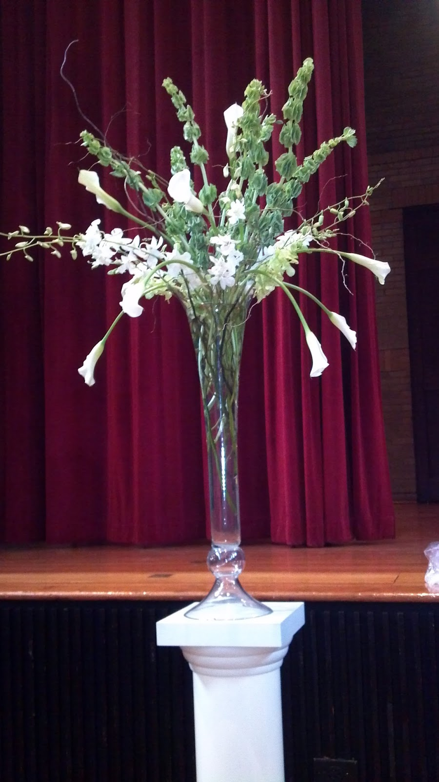 Sweet blossoms llc january 2013 this aisle arrangement is a 30 inch glass trumpet vase filled with curly willow bells of ireland white calla lilies and white dendrobium orchids reviewsmspy