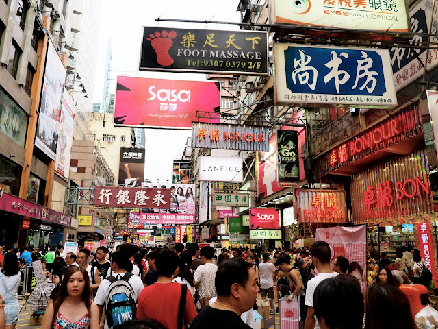Colourful signs & crowds of people on Sai Yeung Choi Street, Mong Kok, Kowloon, Hong Kong