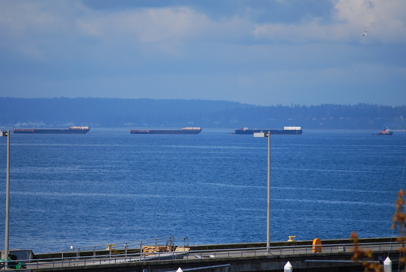 LINE OF BARGES DEPARTS SEATTLE title=