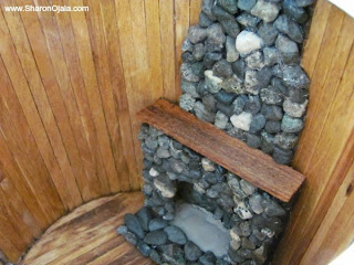 stone fireplace inside dollhouse