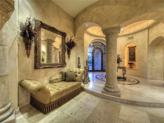 an exquisite ''old world tuscan architecture' estate home on