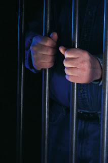 Inmate hands through prison bars