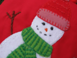 Close up of embroidered felt snowman by The Old Button