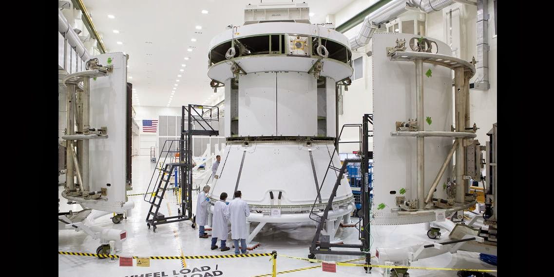 Engineers prepare Orion's service module for installation of the fairings that will protect it during launch this fall when Orion launches on its first mission. The service module, along with its fairings, is now complete. Image Credit: NASA