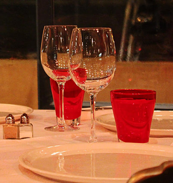 two wine glasses on a set table