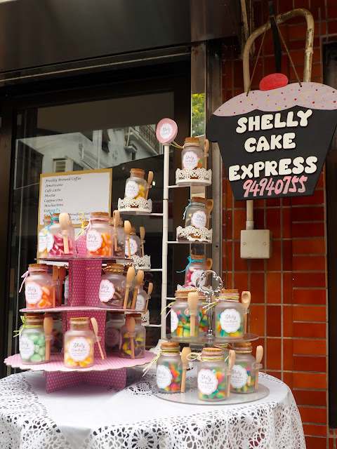 Jars of sweets displayed outside a cake shop in Yung Shue Wan, Lamma Island, Hong Kong