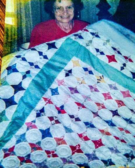 Mom and one of her quilts