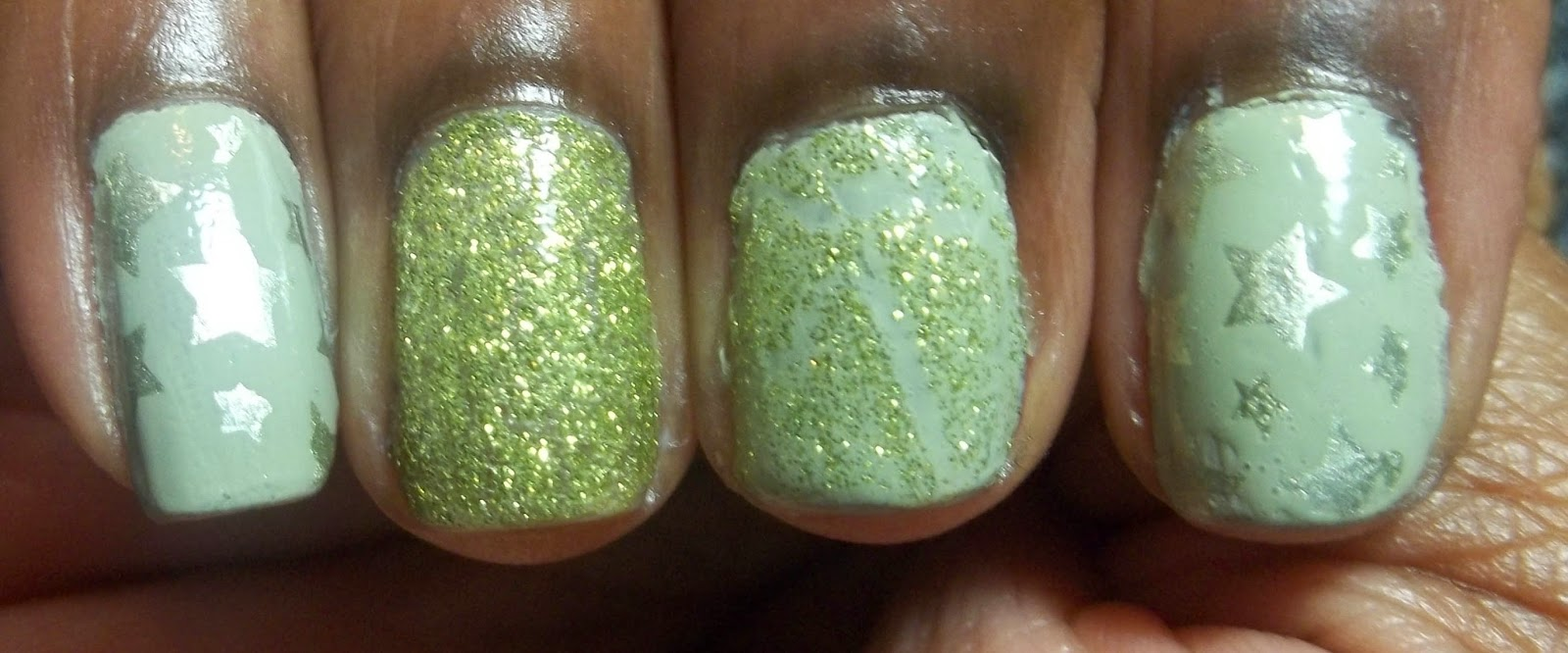 Test using chartreuse crackle glitter polish as a regular polish. Ring finger is painted with the glitter polish, middle finger has the polish applied in crackle form over a light putty green polish. Index and pinky are painted with the light putty green polish, with gold stars stamped on top.
