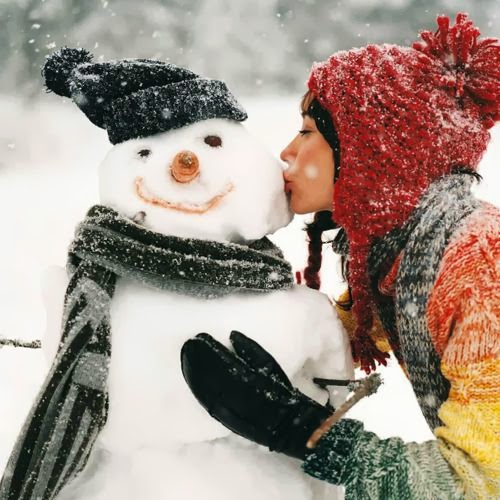 A girl kissing and hugging the snow man
