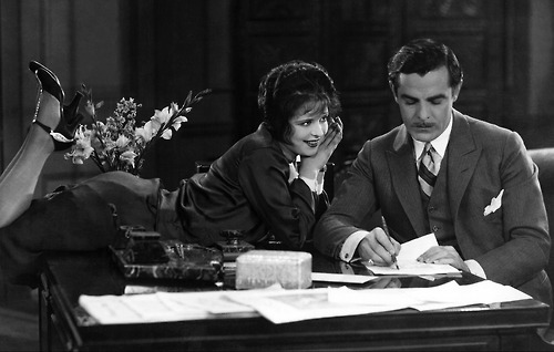 Clara Bow's Betty Lou flirts with her boss Waltham played by Antonio Moreno