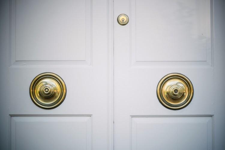 100 year old brass door knobs