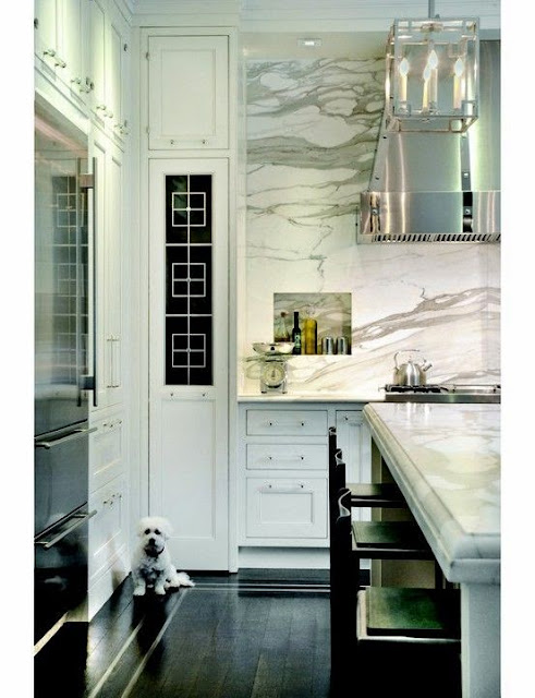 beautiful gray and white marble granite kitchen  backsplash thick white marble counter top dark wood floors