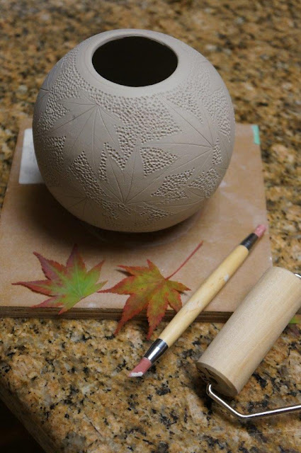 Beautiful nature inspired leaf imprint ceramic pottery hand thrown vessel - in progress.