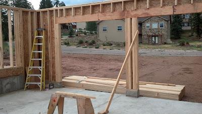 Stannard log home garage for 16 garage door header