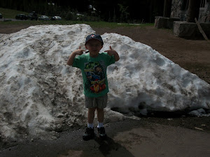 Logan in front snow pile at Crater lake