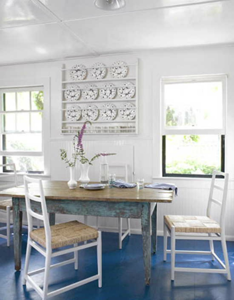 painted blue floors pop in this coastal cottage breakfast area