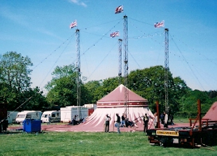 With the tent attached to the cupola the big top is slowly winched aloft by hand. & Circus Mania: Russells International Circus putting up the big top