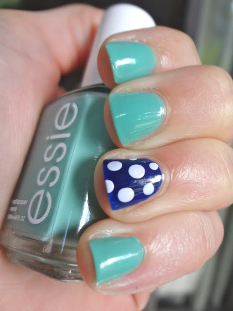 turquoise nails, navy and polka dots accent nail