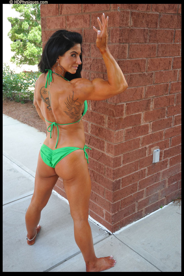 Heather Payne Flexing A Bicep And Modeling Her Muscular Backside