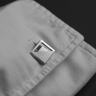 Modern square sterling silver cufflinks on shirt sleeve