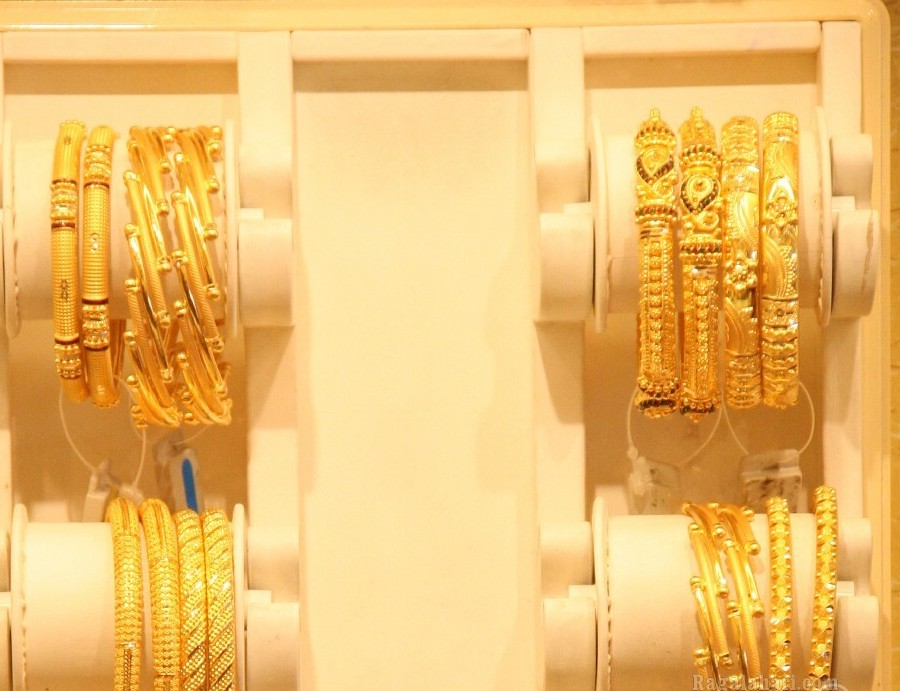 Gold and Diamond jewellery designs: GRT Tallest Bangle Mela