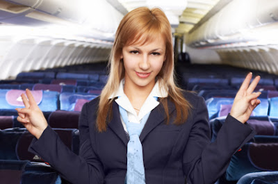 Flight attendant discouraging smoking