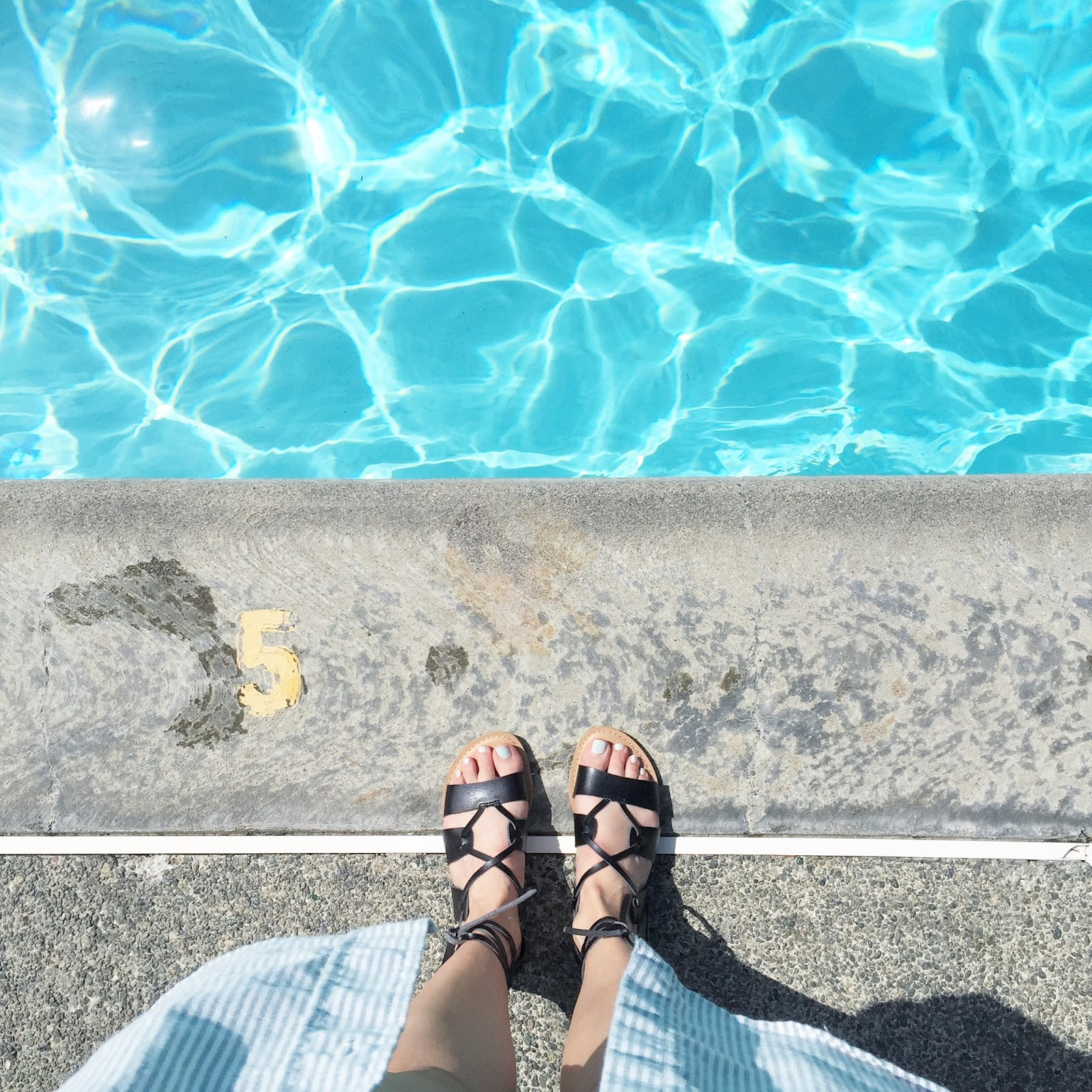 view from the top of gladiator sandals pool side during a hot summer day