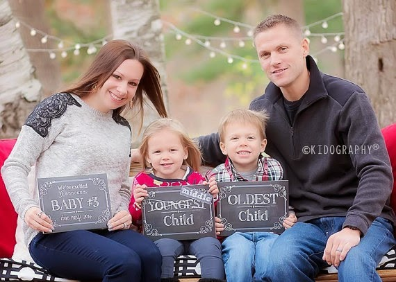 here is another darling photo of these two big brothers announcing baby 3 is on its way