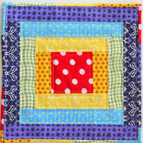 http://thecraftymummy.com/2014/08/rainbow-mini-quilt-tutorial/