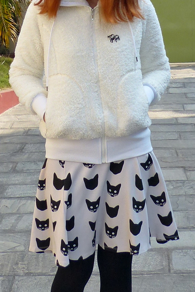 Cat print skirt worn with a white jacket
