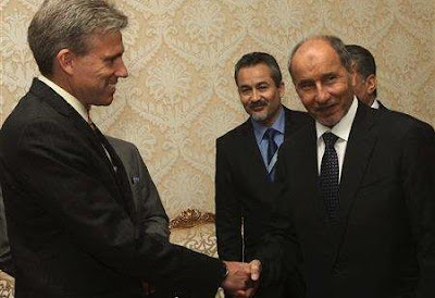 John Christopher Stevens, US ambassador to Libya, shakes hands with Libyan National Transitional Council (NTC) chairman Mustafa Abdel Jalil (R) after presenting his credentials during a meeting in Tripoli, June 7, 2012.