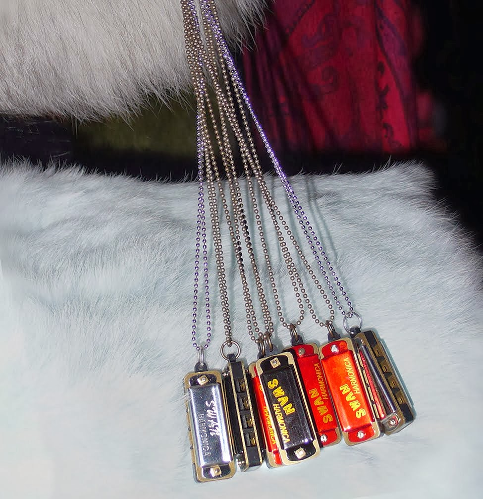 Swan mini harmonica necklaces at the ootra pop up event to benefit the SAIC.